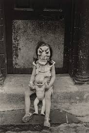 masked child with doll diane arbus